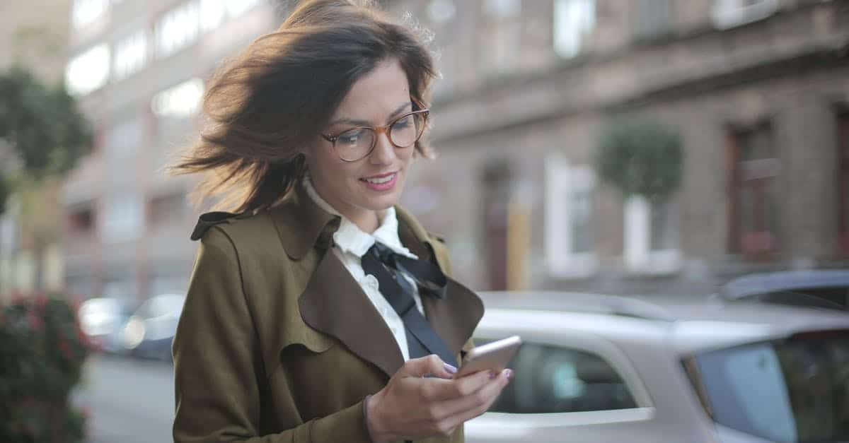 A woman in a car talking on a cell phone