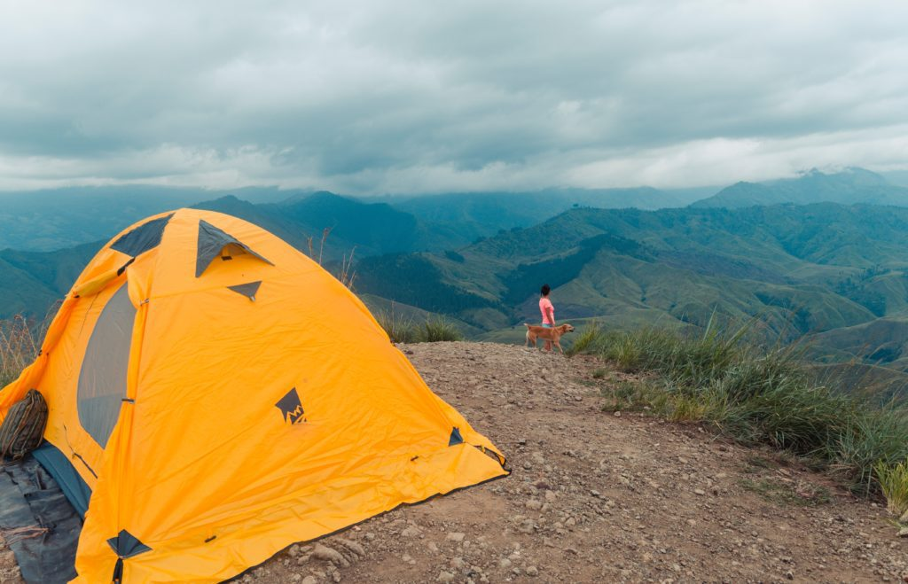 A tent with a mountain in the background